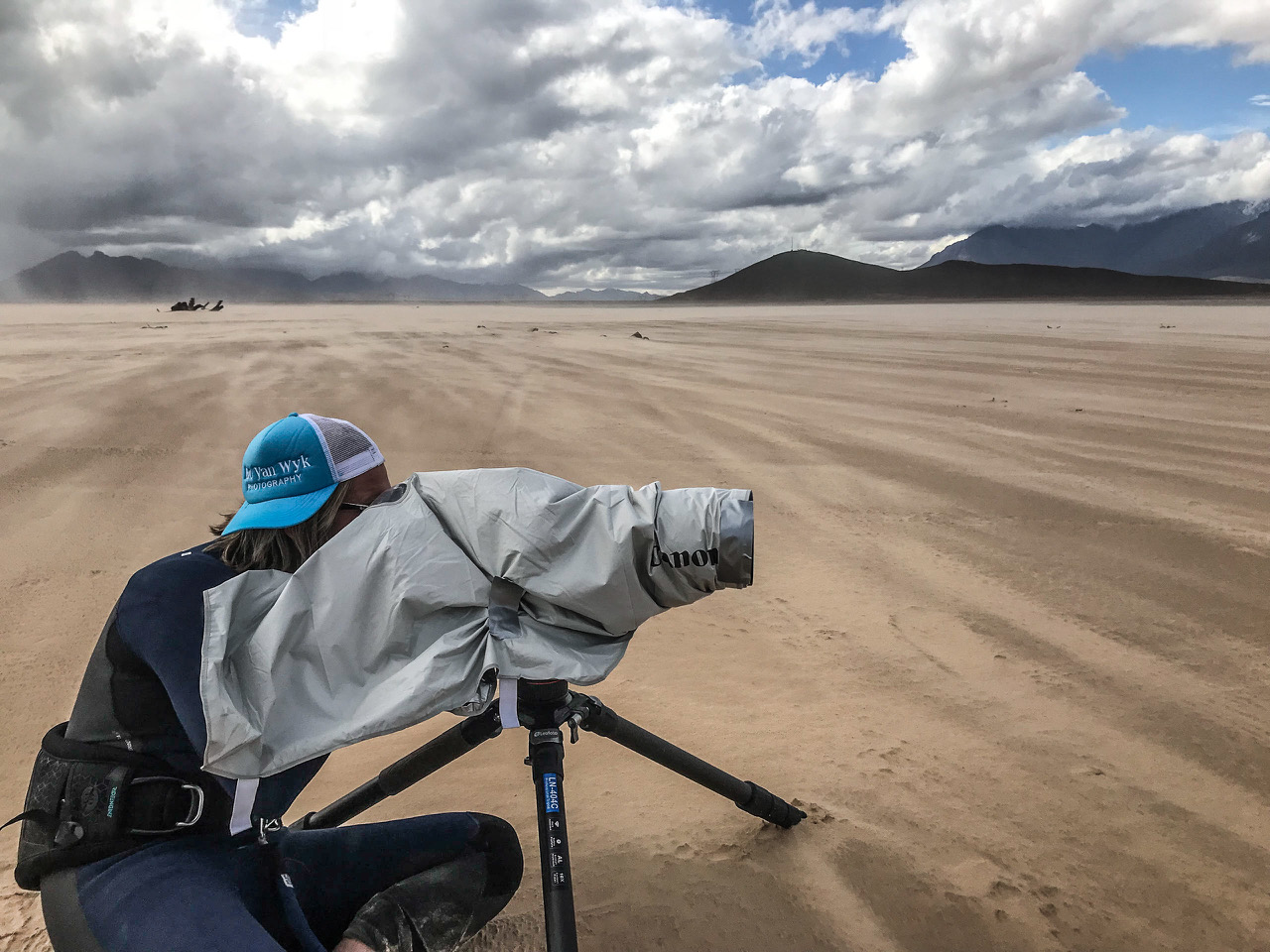 """""""For great shots you have to go to remote places, climb mountains, lay down in the dirt or get yourself sandblasted on the beach.""""     - Bo van Wyk."""